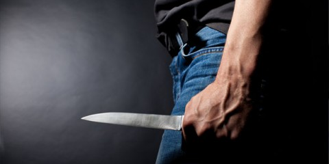 Man-holding-a-knife-via-Shutterstock