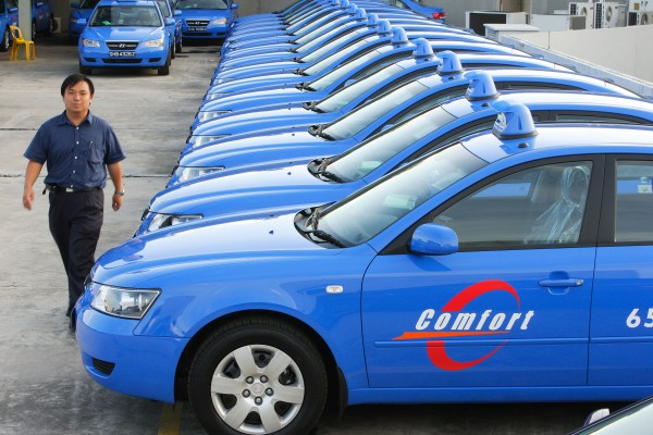 Some of ComfortDelGro Corp.'s new taxis are parked at the Hyundai dealership in Singapore on Thursday, May 10, 2007. ComfortDelGro operates the world's second-largest fleet of buses and taxis.    Photographer: Jonathan Drake/Bloomberg News