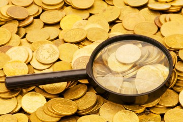 photodune-2139120-magnifying-glass-and-lots-of-gold-coins-s