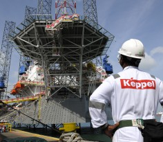 A Keppel Corp. employee looks at the Transocean Andaman jackup rig, built for Transocean Ltd., during a naming ceremony at the Keppel FELS shipyard in Singapore, on Saturday, Feb. 2, 2013. Keppel Corp.'s FELS unit received a combined $1.5 million bonus for completing the construction of two drilling rigs ahead of time, the company said in a statement. Photographer: Munshi Ahmed/Bloomberg