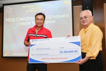 Raymond Lau, Managing Director at Qilin World Capital (left), presents a cheque of SGD200,000 for ME92 Scholarship (Endowed) to National University of Singapore's Engineering Faculty representative.