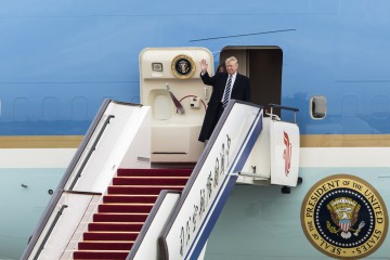 U.S. President Donald J. Trump and first lady Melania Trump disembarks from Air Force One on the runway of the Beijing Capitol Airport in Beijing, China on Wednesday, 08 November 2017.