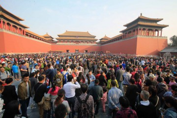 BEIJING, CHINA - OCTOBER 04:  (CHINA OUT) Tourists visit the Forbidden City during the National Day holiday on October 4, 2015 in Beijing, China. Many scenic spots in China have welcomed the tourism peak during the 7-day National Day holiday.  (Photo by ChinaFotoPress/ChinaFotoPress via Getty Images)