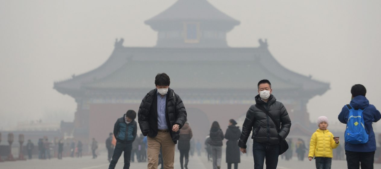 BEIJING, CHINA - FEBRUARY 24: (CHINA OUT) People wearing masks walk on Danbi Bridge at the Temple of Heaven Park on February 24, 2014, in Beijing, China. Altogether 1.43 million sq km of China's land territory, nearly 15 percent of the total, have been covered by persistent smog in recent days, according to news report. (Photo by ChinaFotoPress/Getty Images)
