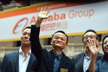 Chinese online retail giant Alibaba CEO Jack Ma (C) waves as he arrives at the New York Stock Exchange in New York on September 19, 2014. Alibaba is poised for a record-breaking stock market debut on September 19, with shares priced at $68 in a public offering that could be valued at $25 billion. The company will step into the spotlight on the New York Stock Exchange, priced at the top of the $66-$68 per share range announced earlier this week, according to documents filed with US regulators. AFP PHOTO/Jewel SamadJEWEL SAMAD/AFP/Getty Images
