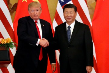 FILE PHOTO: U.S. President Donald Trump and China's President Xi Jinping make joint statements at the Great Hall of the People in Beijing, China, November 9, 2017. REUTERS/Jonathan Ernst/File Photo